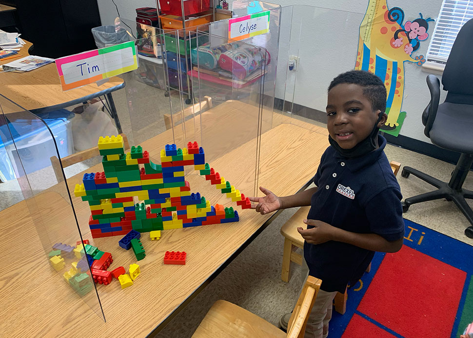student building lego wall
