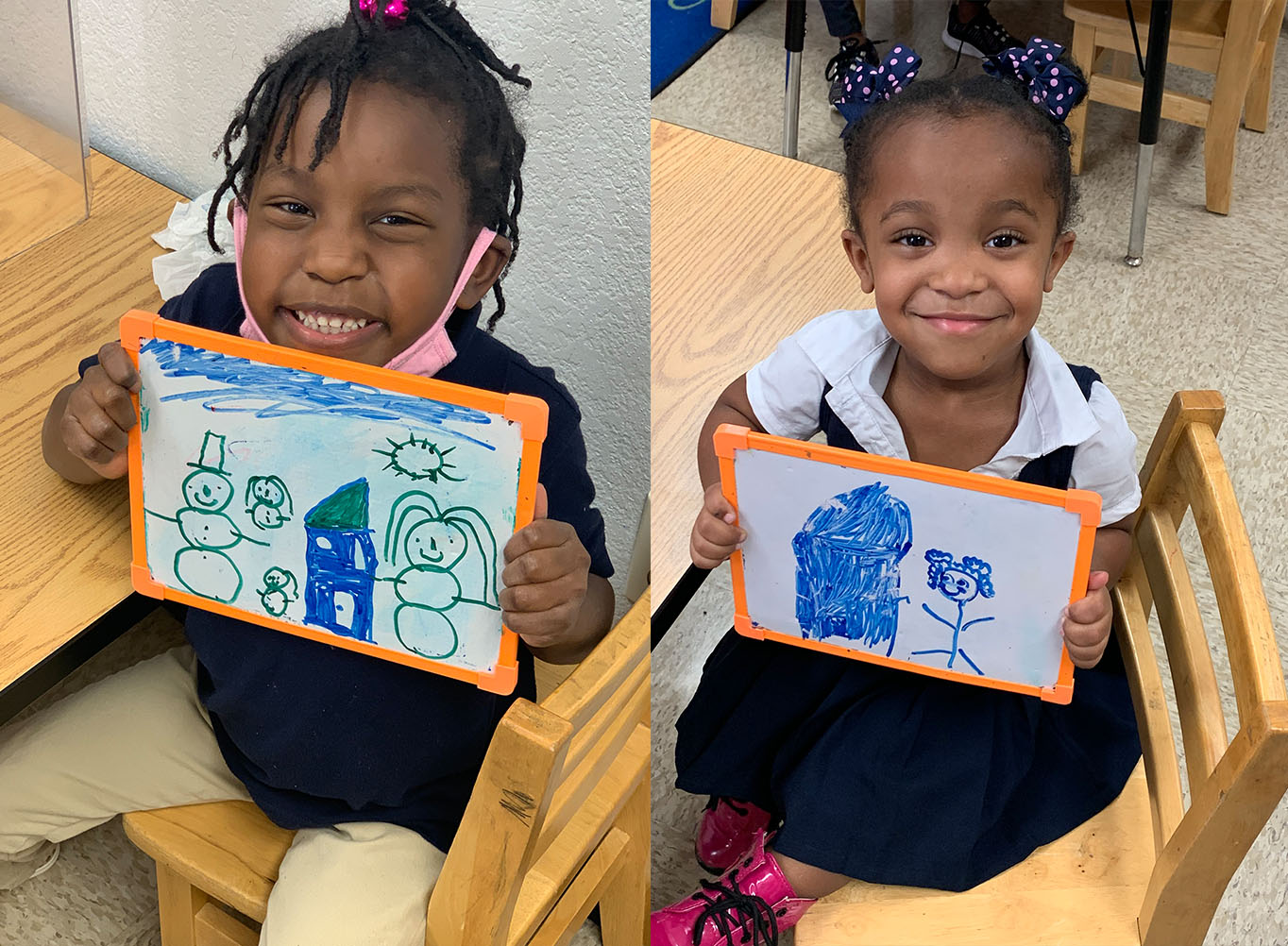 Happy Preschool children holding pictures