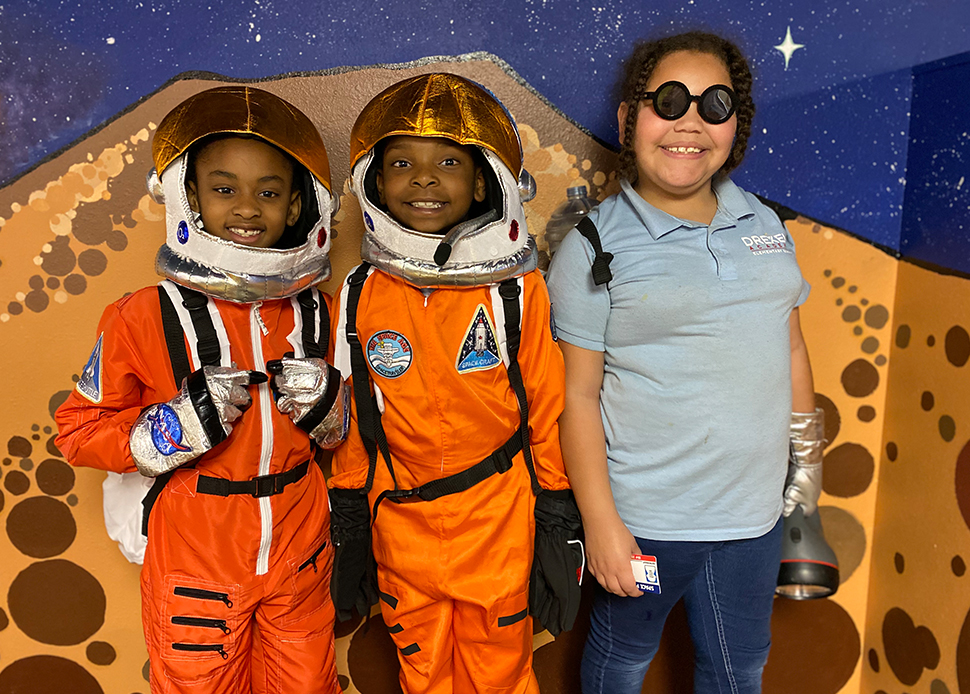 S.O.L.E. students in NASA space suits