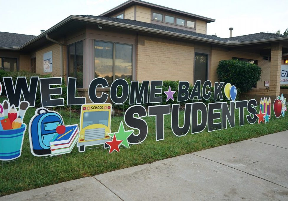 welcome back students sign in front of school