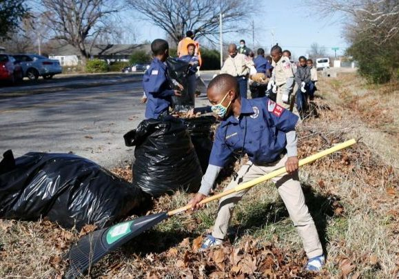 Boy Scout Troop 1921 cleaning up the side of the road