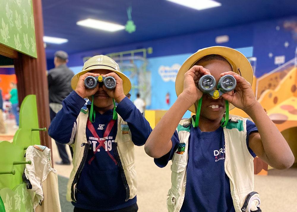 kids looking through binoculars